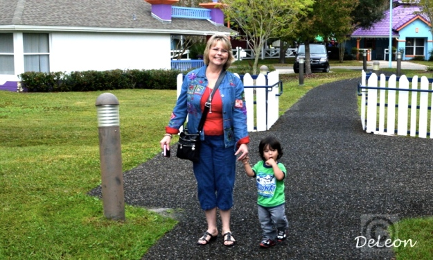 Walking through the village headed to the park. Tristan with his godmother.
