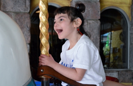 Riding the Merry go round, having so much fun.